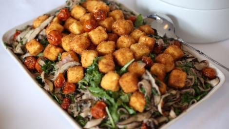 Fried feta, arugula, roasted portabello mushrooms, over roasted tomatoes with berry vinaigrette.